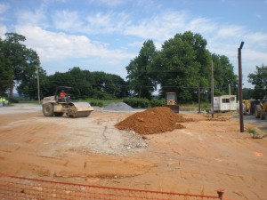 Raising the level of the old parking lot area.