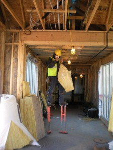 Now there's a work tool any kid would love to try! He's using them as he installs insulation in the walkway.
