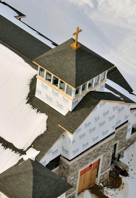 Winter aerials--sledding, downtown Frederick, St. Joseph's, cows