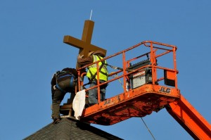 Installing cross on new St. Joseph's church